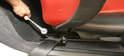 Next, move the seat all the way forward to uncover the two rear mounting bolts.