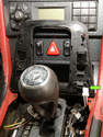 The plug for the passenger's side airbag-disabling button is gently pulled out.