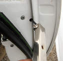 Use a 4mm hex/Allen wrench or bit to loosen the screw.