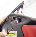 The side mirror assembly attaches to the door with three screws (purple arrows).