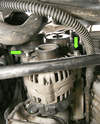 Looking straight up, the alternator's two mounting bolts are at about 11:00 and 4:00 in relation to the pulley (green arrows).