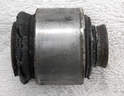 Worn bushings are often obvious.