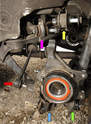 The axle shaft, emergency brake, and backing plate were removed for other articles, making the link arms more visible.
