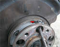 Please see the article on caliper and rotor removal for details.