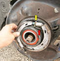 Removing the wheel hub is a pain and isn't necessary to replace the parking brake shoes; ours was already off to replace the wheel bearing.