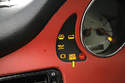 The dreaded Check Engine light (arrow) stays illuminated when the car's computer registers a diagnostic trouble code (DTC).