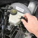 Begin by unplugging the fluid-level sensor lead from the master cylinder.