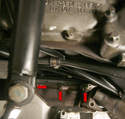 While underneath the car, have a go at the exhaust manifold's lower nuts.