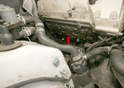 The new exhaust manifold gasket (arrow) installs over the studs.