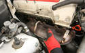 Once all 11 nuts are off, the exhaust manifold can be removed.