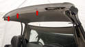 Three Phillips screws (arrows) retain the headliner's front edge to the roof.
