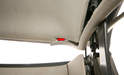 For installation, make sure that the headliner slots into the rear channel (arrow).