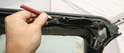 The upper windshield panel must be removed to access the Roof Closed Limit Switches.