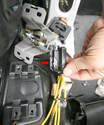 The Trunk Closed switch bracket/cable release mechanism comes apart by using a T27 Torx bit.