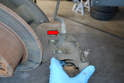 With the caliper removed from the hub you can spin it off of the brake line (red arrow) and you will need to install the new caliper in the same manner.