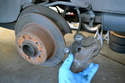 You will need to remove the brake caliper to replace the rotor so please see our article on replacing your rear brake calipers for additional assistance.