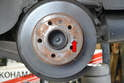 The rotor is held to the hub by the clamping force of the wheel lugs.