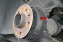 The parking brake pads use the inside of the rear brake rotor (red arrow) so you need to remove the rotor to access them.