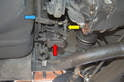 This photo illustrates the leveling valve unit (red arrow) with the adjustable leveling bar (yellow arrow) and how it attaches to the sway bar (blue arrow).