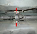 If you cannot compress the drive shaft enough, you may have to lower the drive shaft bearing by loosening the two 13mm bolts holding it in place (red arrows).