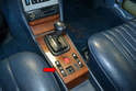 The center console panel (red arrow) must come off first before you can remove the shift knob and shaft.