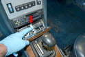 While there are no visible forms of retaining the console in place it is very easy to remove.