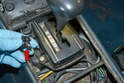 Use a small flathead screwdriver and carefully pry out the shift cover light (red arrow).