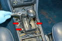 Next, use a 10mm socket and remove the three 10mm bolts holding the cover over the shaft.