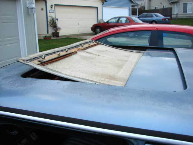 Slide sunroof headliner forward and out the top of the sunroof opening.