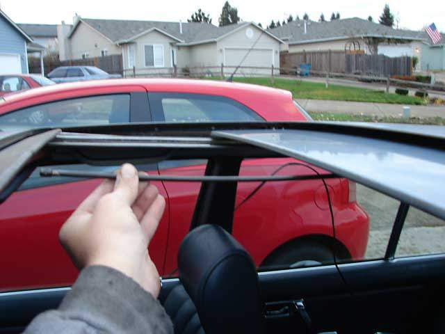 Press the sunroof cable backwards until you feel resistance, then use the motor to pull the cable backwards until the end is near the front of the guide tube.