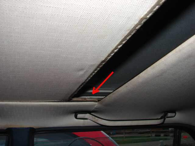 Slide the sunroof headliner back under the sunroof the same way it was removed.