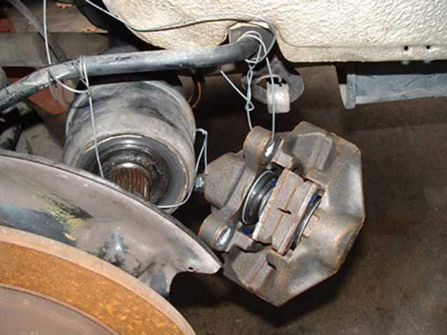 Hang the axle and caliper with wire, out of the way.