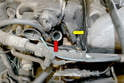 With the valve off make sure to clean up the exhaust pipe (red arrow) and intake (yellow arrow) before installing the new valve.