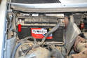 Before you start working on the alternator make sure to disconnect the ground strap on the battery (red arrow) and place it somewhere where it cannot accidentally come in contact with the post while you are working.