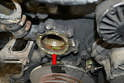 Use a plastic blade to scrape any old gasket or RTV off the housing and make sure to clean the mount flange and inside with a little Emory cloth to give you a clean flush mounting surface.