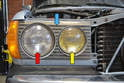 The US market W123's come with a sealed headlight (red arrow) and a sealed fog light (yellow arrow), whether you have the sealed beams or the Euro version you will need to remove the front surround (blue arrow) to change the bulbs or lights.
