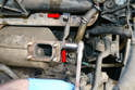 Use a 17mm socket and remove the three bolts that hold the mounts to the trap and engine block; two are shown (red arrows) and one is down below.