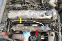 You will need to pull the intake manifold (red arrow) forward first but on some models it will not clear the exhaust manifold (yellow arrow) so reach down and wiggle the exhaust manifold forward until the intake will clear.