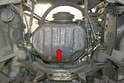 You are going to lift the motor from below using the oil pan (red arrow).