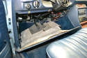 The panel will now drop down and can be removed from the footwell.
