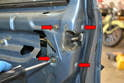 Use a Philips head screwdriver and remove the four screws holding the latch to the door (red arrows).