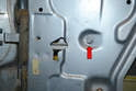 There is a single 10mm bolt that holds the stop to the panel of the door (red arrow).