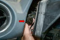 Gently pull the cluster forward until you can separate the electrical connections on the left side (red arrow).