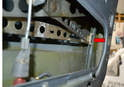 The regulator will need to be lowered and removed from the channel in the door (red arrow).