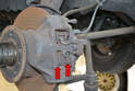 The front brakes on the W123 are a dual piston caliper and both pads (red arrows) can be replaced without removing the caliper.