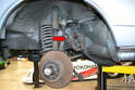 Begin by safely jacking up and supporting the vehicle and removing the front wheel.