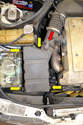 There are two clips that hold the air box lid to the intake and MAF (red arrow, one shown, one below) and four clips that hold the lid to the air box (yellow arrows).