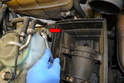 To remove the air box, remove the 10mm nut and bracket by the windshield washer reservoir (red arrow).