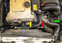 The thermostat (red arrow) is located on the top of the water pump between the cylinder head (yellow arrow) and the power steering reservoir (green arrow).