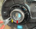 There is a good chance the inner race of the bearing will come out with the hub (red arrow).